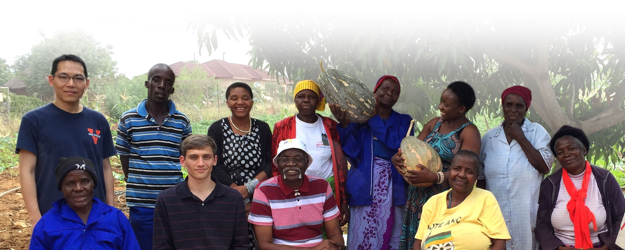 Cameron Haddad and Kamwoo Lee posing with a group of South Africans in Limpopo, South Africa.